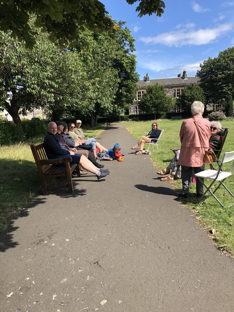 Seven members and three family enjoying a natter in the park
