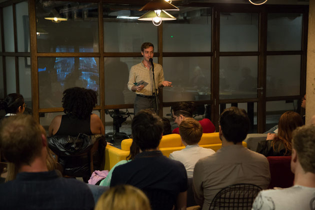 A writer reads at a live Untitled event