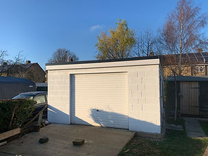 Construct garage shell -  construct roof and cover with single ply membrane, fit garage door.