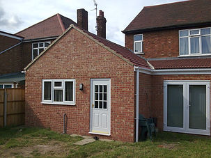 Construct single storey 'wrap-around' extension to create new lounge, kitchen, utility and dining areas