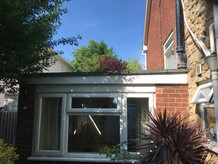Flat roof conversion to tiled roof with