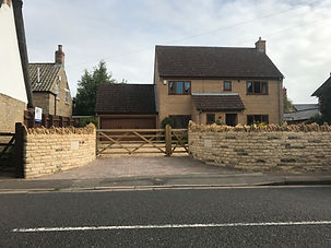Stone wall, electric gates and Landscaping