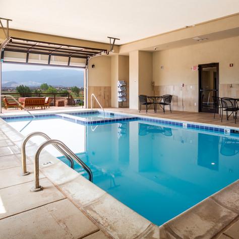 Pool with door open to patio