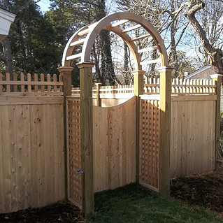 Arbor with Colonial Accent Top Cedar Board Fence