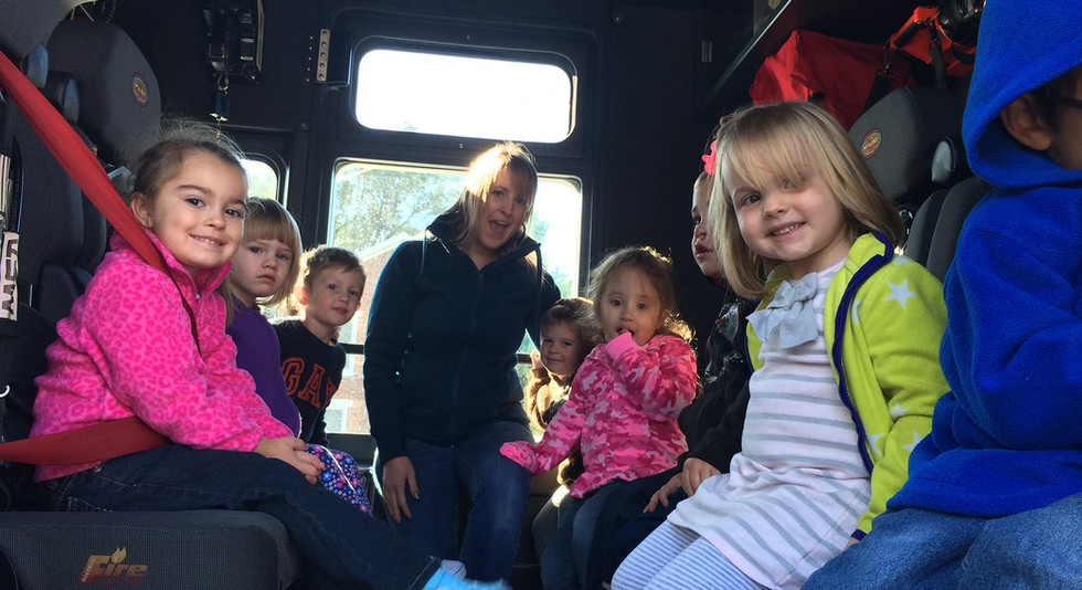 In the fire engine!