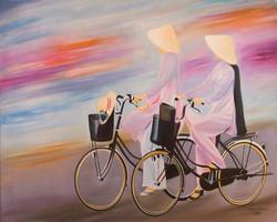 School girls on bicycles