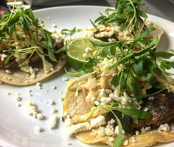 Smoked brisket tacos, spicy slaw, queso fresc, cilantro, corn tortilla, lime tacos a TexiKo