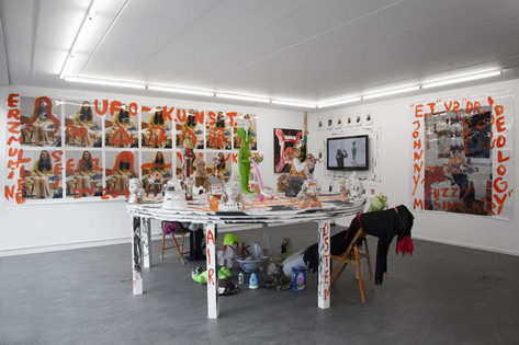 "JONATHAN MEESE THE TOTAL ""ANTI-MAGICK"" TABLE OF EVOLUTION  (VINCENT PRICE IS BACK, SUPER, SUPER, SUPER, ...), 2017 wooden table, chairs, styrofoam, acrylic modelling paste, acrylic, mixed media, sculptures ⌀ 300 x 100 cm (wooden table), dimensions variable"