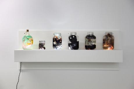 GELITIN Reine Magarine Rilke Jean Jacques, 2013 plush, oil, bottle, light box 52 x 165 x 24 cm