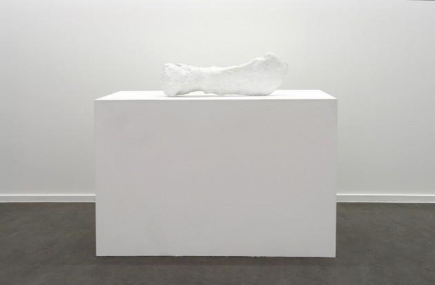 "FRANZ WEST: ""Heaviness"", 1990 - Bronze cast: 16 x 63 x 26 cm, Pedestal: Bronze 71 x 104 x 60 cm HEIRI HAEFLIGER: ""leaving culture"", 2005 - papermâché, computer screen, adhesive foil - Pedestal156 x 34 x 30 cm, Monitor 42 x 45 x 41 cm"