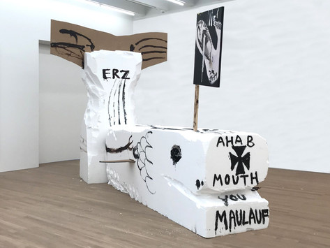 "JONATHAN MEESE DEIN WALBEOBACHTER ""AHAB"" SCHWÖRT: ICH BIN FÜR REINEN SEXUELLEN WALFANG, SORRY, ABER SO IST'S.... (MOBY DICKY DITT MI LITT), 2019 styrofoam, acrylic, pasteboard, wood ledge, painting 355 x 273 x 100 cm, 285 x 200 x 400 cm"