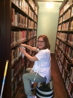 Staff here in Huntington were busy this summer, doing extra cleaning to insure that it is safe for returning visitors. Here is Lily from Housekeeping, working in the stacks. Thank you!