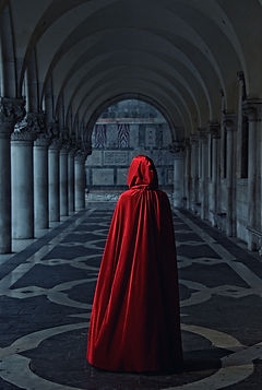 Woman in red cloak walking away.jpg