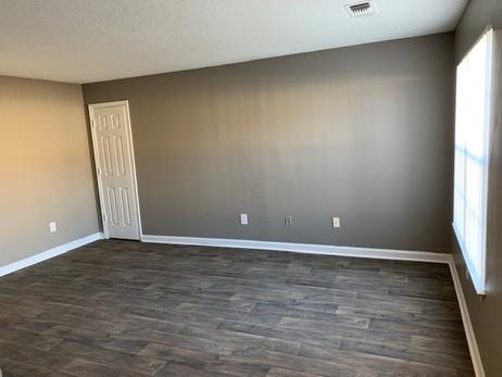 Bedroom with wood flooring