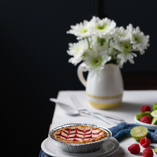 Dramatic table scape with pie and fruit