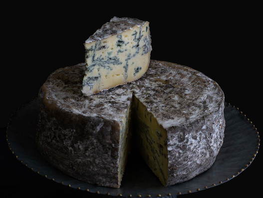 Food photography of gourmet blue cheese wheel