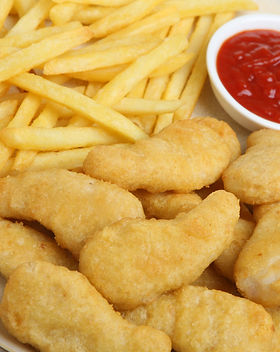 Chicken nuggets with fries and tomato ke