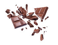Chocolate broken into pieces in the air