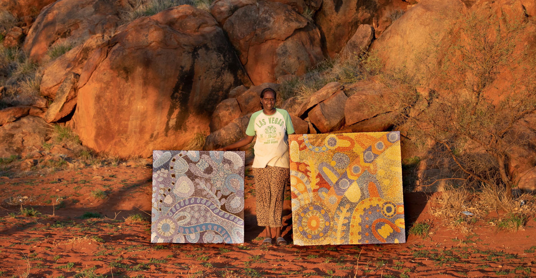 Josina Pumani with her paintings in Mimili Community, photo: Meg Hansen