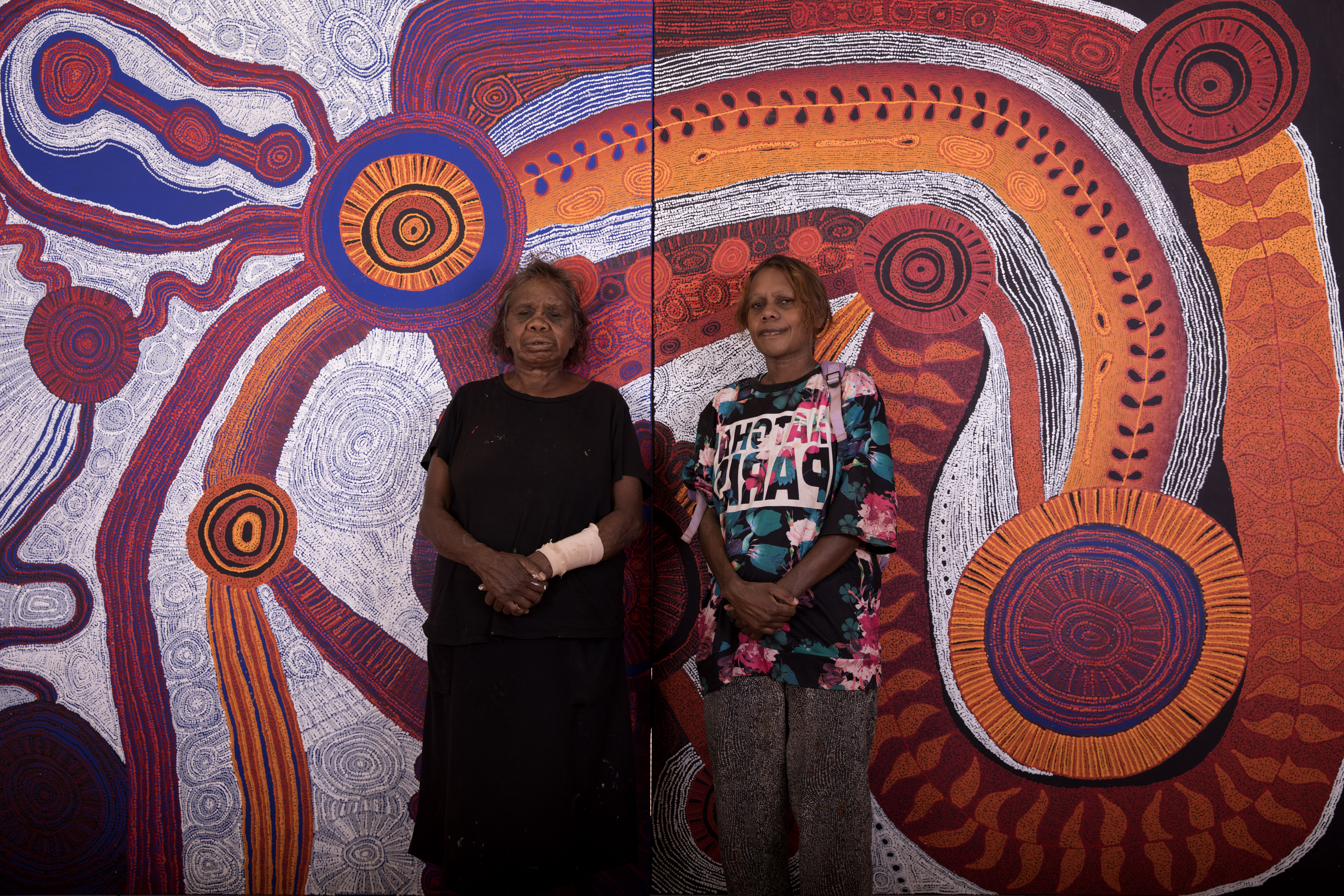 Betty Kuntiwa Pumani and Marina Pumani Brown in front of their collaborative canvas, photo: Meg Hans