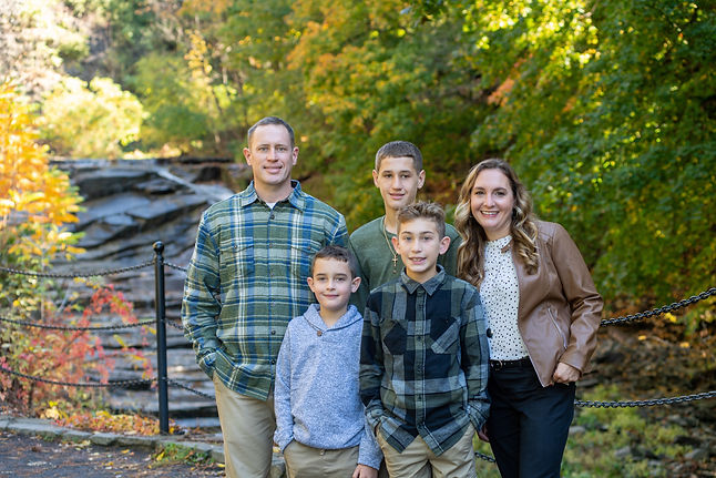 Dr Barton chiropractor with family outside Ithaca NY in the fall