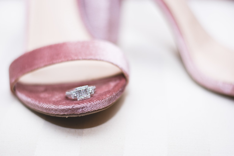 wedding ring on bride's shoe