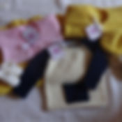 Knitting cardigans in yellow, pink, white and blue and corcheting white boots from killy's wand