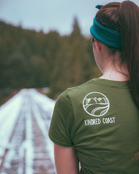 Kindred coast logo on back shoulder