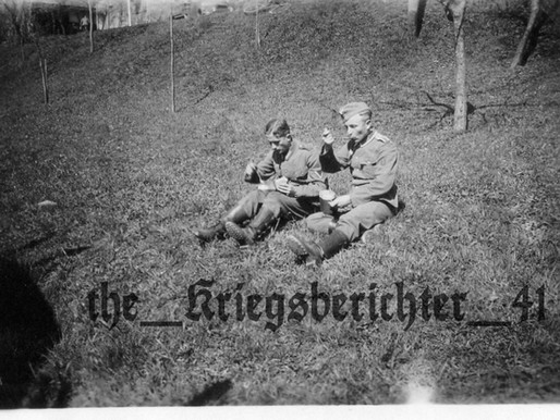 A Gefreiter and Funker Eating in the field
