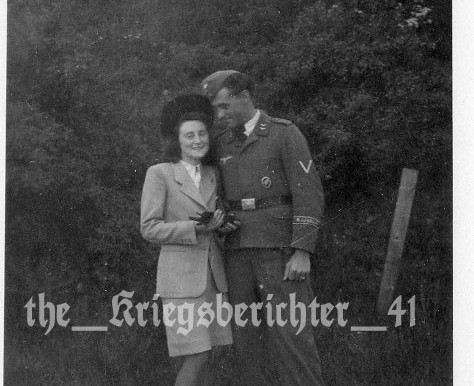 A Fallschirmjäger Gefreiter with Afrika Cuff on leave with wife