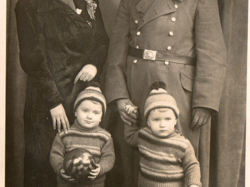Flak Unteroffizier with his Wife and Two sons; Hannes and Willi