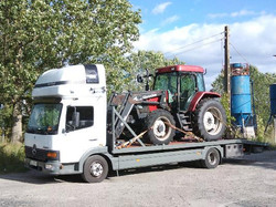 перевезти трактор