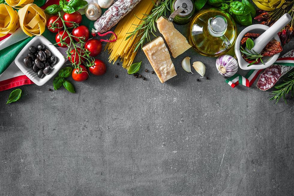 Italian food ingredients on slate backgr
