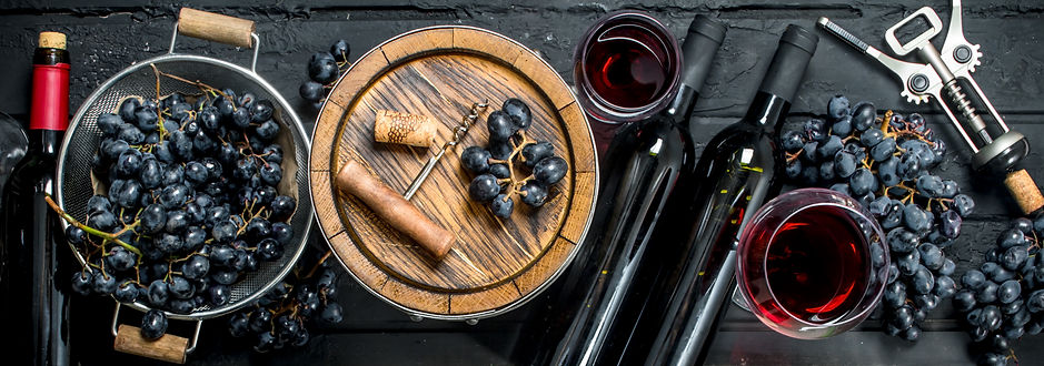 red-wine-with-grapes-old-barrel.jpg