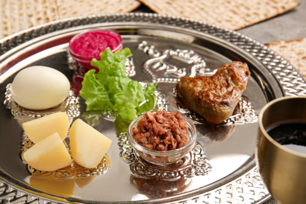 A set Seder plate on a Passover table