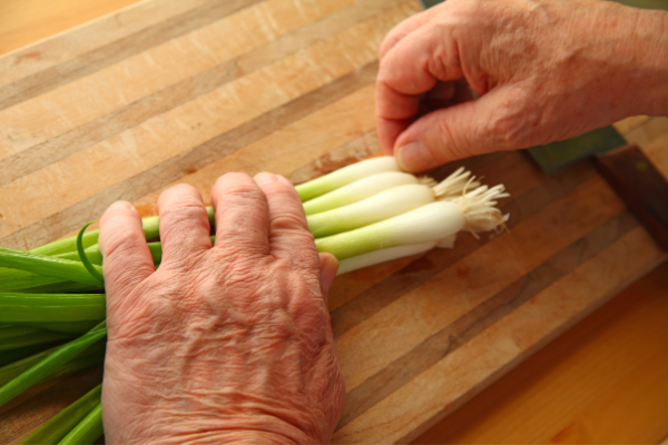 A bunch of green onions on a cutting board