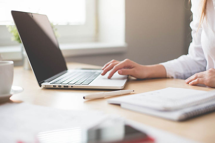 Woman's hands on desk using laptop