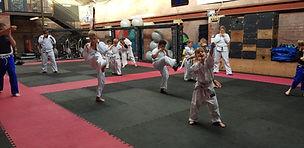 Beginners doing martial arts