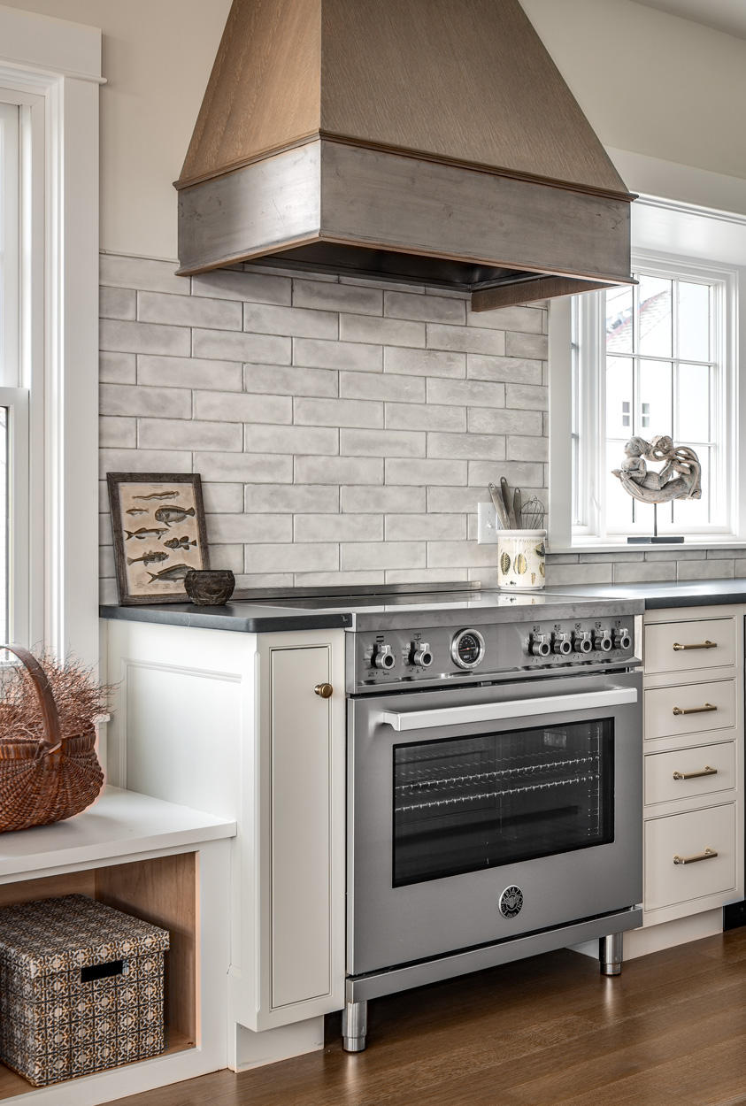 High end appliances like this Bertazzoni range complete the look and function of the space.