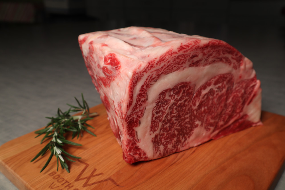 An image of uncooked Wagyu Prime Rib on a cutting board