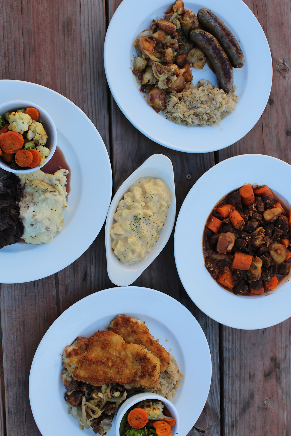An image of 5 plates of food offered on the Powercat Oktoberfest Menu