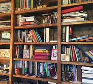 Professional Organize Tackling Visual Clutter in Bookshelves Before