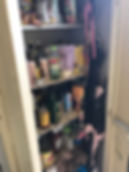 Before Cluttered cabinet in laundry room