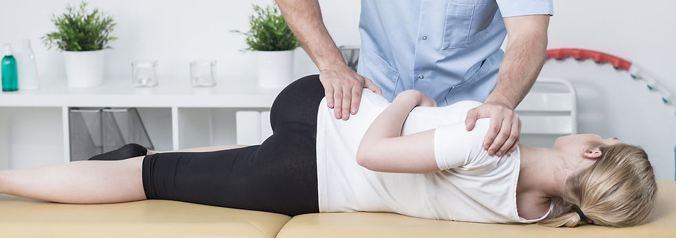 physical-therapist-manipulating-lower-ba