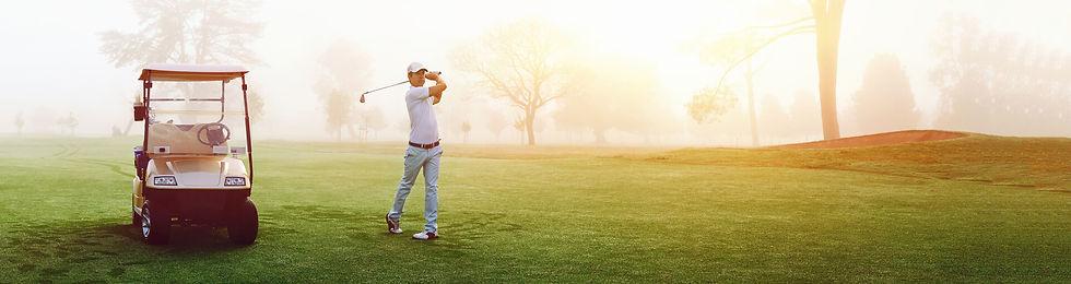 man-on-golf-course-swinging-golf-club.jpg