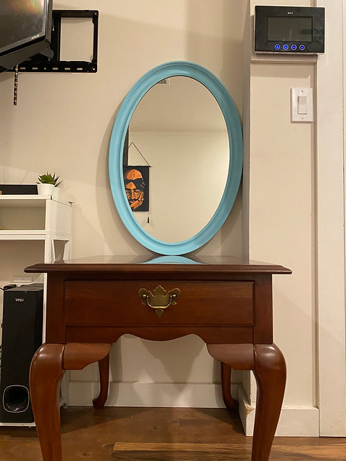 Modern sleek oval ocean mirror