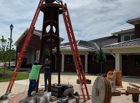 Installation underway for sculpture inspired by chimney at Shelby Iron Works Park