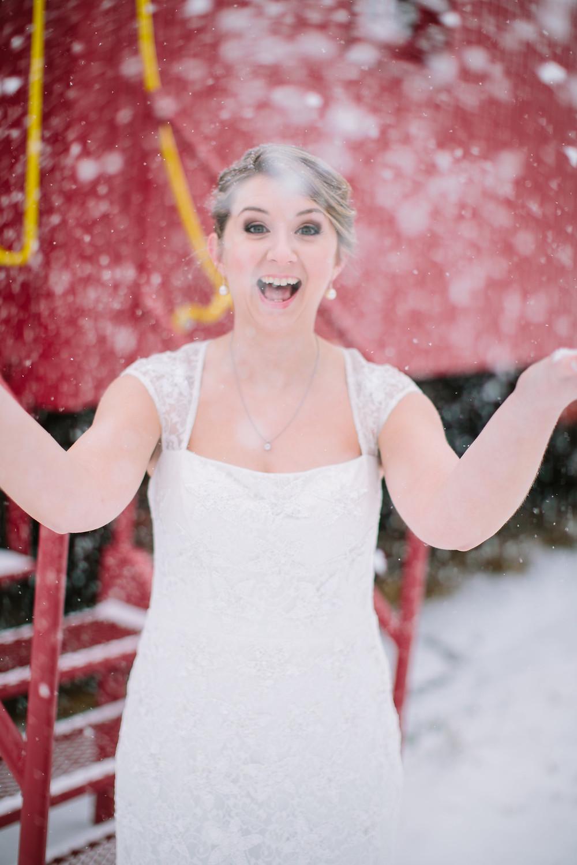 Cara throwing snow balls in her wedding dress.