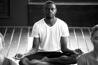 young-sporty-black-men-practicing-yoga-l