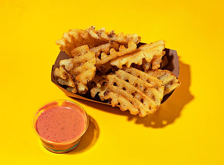 WingSlut's side of Szechuan fries with bougie dipping sauce in San Francisco.